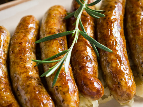 Juicy,grilled,sausages,with,cabbage,salad,,mustard,and,beer